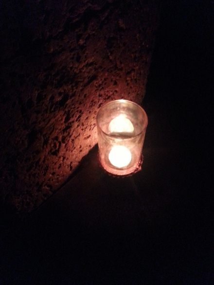 One of the votive candles placed to light the corridor outside the restaurant