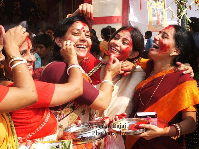 No.. It's not Holi.. Just some Bengali women during shidur khela! Pic courtesy: Varun Bajaj on Flickr