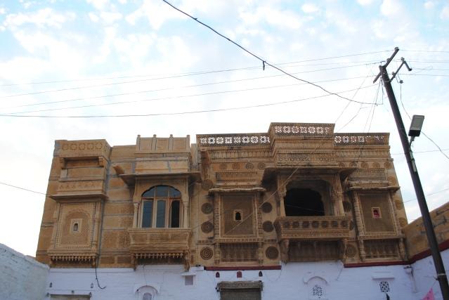 Modern glass shutters on a centuries old jharokha (window), what a blend!